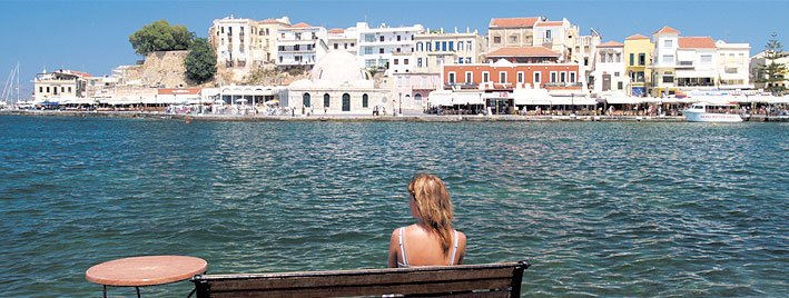 Water, buildings and sun in Crete