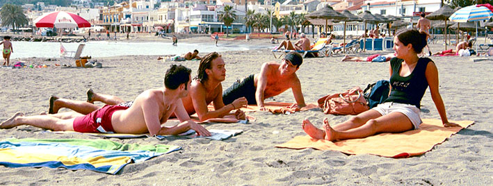 Students on the beach in Malaga