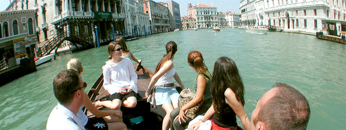 Language students discovering Venice by boat