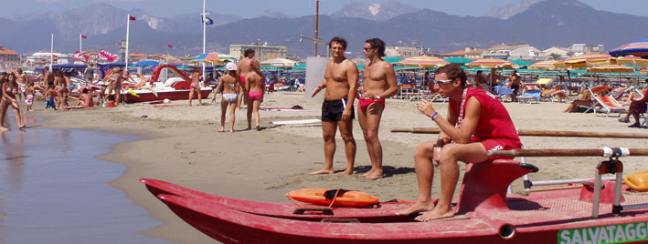 Lifeguard and Italians on beach, Viareggio